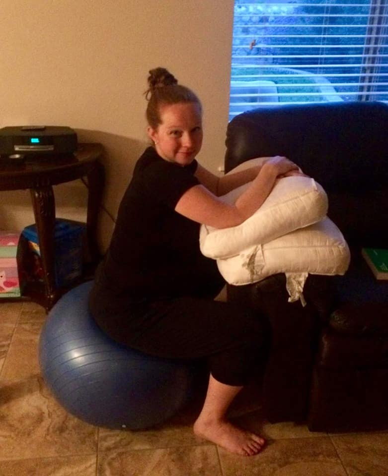 Hypno-mom Julia sitting on birth ball and smiling