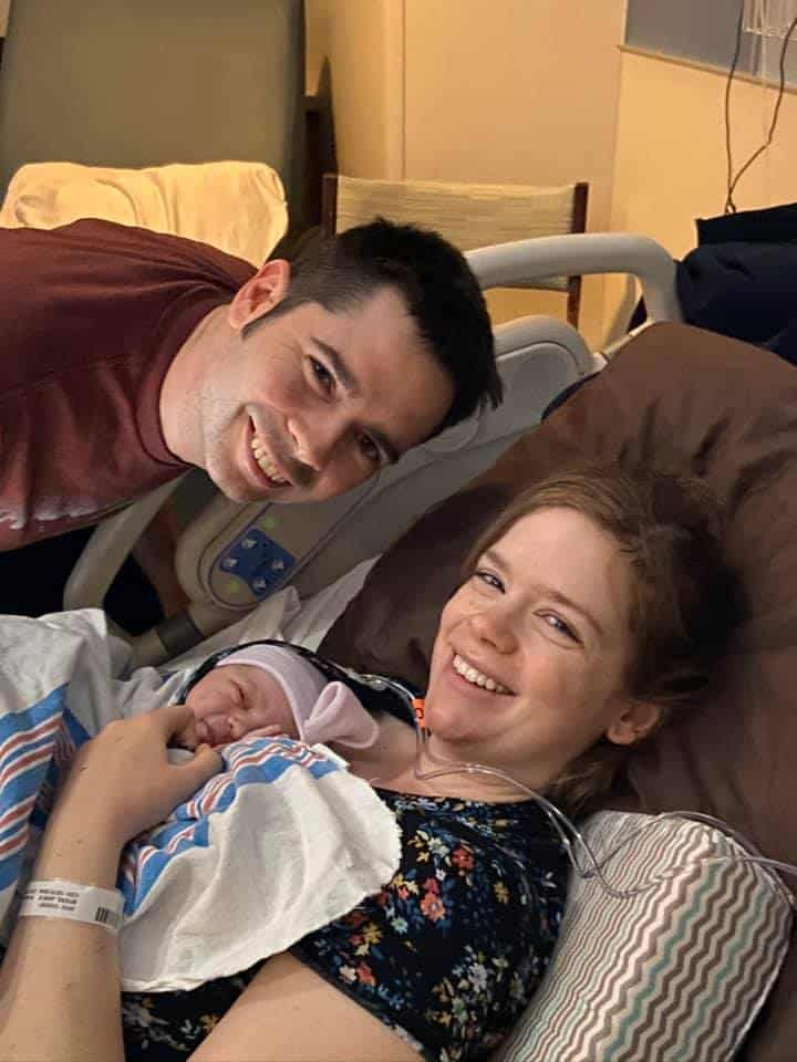Hypno-mom and partner smiling with newborn in hospital