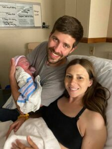 New family in hospital holding newborn