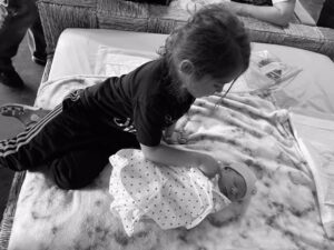 Sibling meeting new baby brother