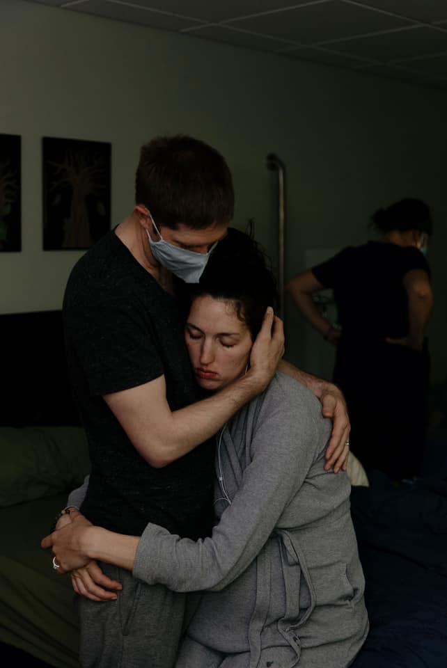Hugging Birthing Couple